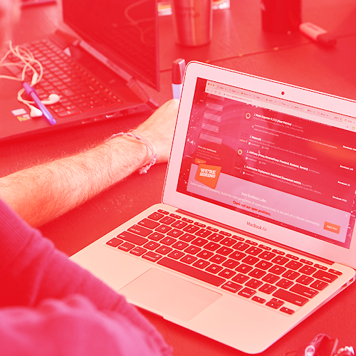 A student at a laptop with a red Ubiqum filter