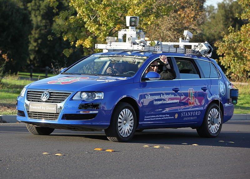 A blue Volkswagen driverless car attempts to park